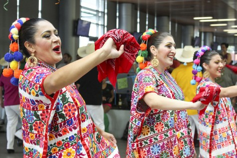Dancers from the Los Altenos Dance Troop wave to the students gathered to watch their performance in the Student Center during the Latino Heritage Celebration on Thursday, Oct. 8, 2015. (Photo by Barbara Harvey)