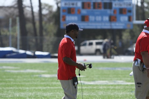 Coach Wheeler walks onto the field during a time out during American River College's 42-10 loss to College of San Mateo on Saturday, Oct. 3, 2015. (Photo by Barbara Harvey)