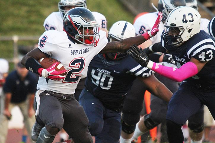 American River College linebacker Patrick Walker charges after College of the Siskiyous running back Lashone Garnett as ARC defeated COS 49- 31 on Saturday, Oct. 18, 2015. ARC dominated defensively in the first half, holding COS to just 3 points at halftime. (Photo by Barbara Harvey)