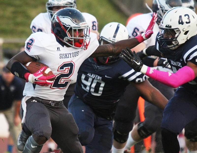 American River College linebacker Patrick Walker goes after College of the Siskiyous running back Lashone Garnett during ARC's 49-31 victory over COS on Saturday, Oct. 18, 2015. Walker recorded 3 tackles, one tackle for a loss of 4 yards and a quarterback hurry. (Photo by Barbara Harvey)