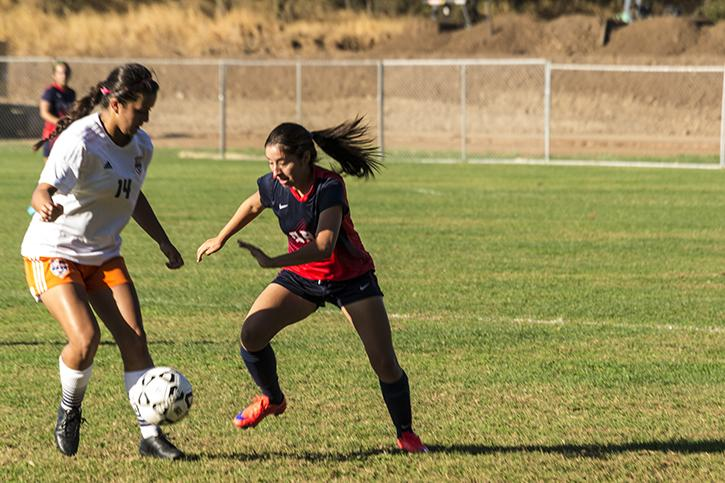 American River College's Jocelyn Tamayo fights for the ball against Cosumnes River College's Taylor Arlin during its match at ARC on Oct 16.  (Photo by Joe Padilla)