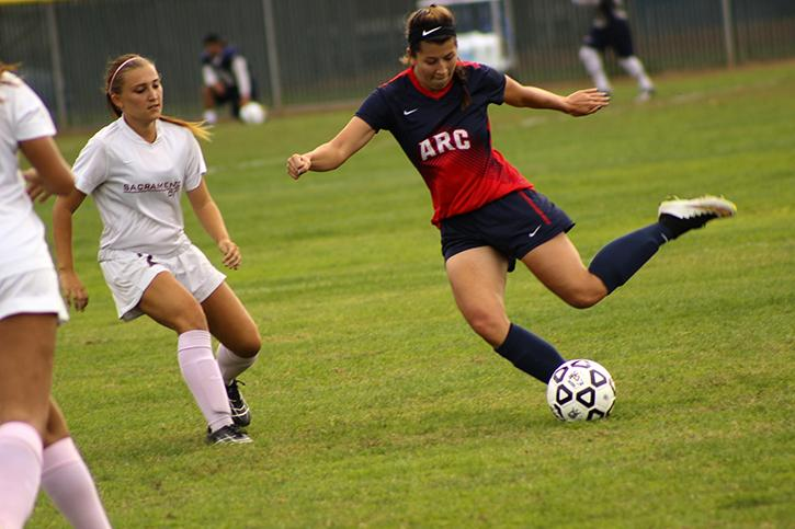 Midfielder Gabby Krewer passes the ball to a teammate in her game against Sacramento City College. The American River College womens soccer team defeated Sac City 3-0. (Photo by Joseph Daniels)