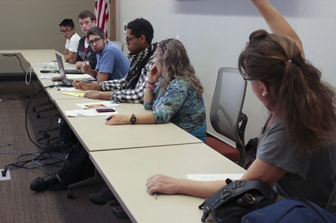 Student Senate President David Hylton, in the blue shirt, calls upon Sen. Regina Drake, who raises her hand to volunteer for the election committee that would go into effect if Hylton is recalled. A student petition was brought before the board calling for a recall after Hylton expressed support for Los Rios Student Trustee Cameron Weaver, who came under fire for his skepticism about the Holocaust. (Photo by Jordan Schauberger)