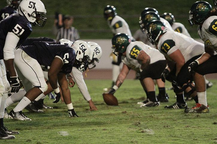 American River College's defence line and Feather River College's ofecive line stare each other down before the snap during last years game where ARC won 44-8. ARC and FRC will have a similar scene coming Oct.24 in ARC's second conference game of the season.  ( File Photo)