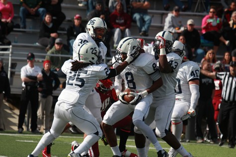 Former American River College cornerback Malcolm Scott celebrates with teammates after an interception in last season's 31-22 win over Sierra College. ARC has defeated Sierra in two of their last three meeting and looks to improve its conference record to 3-0 on the season. (File Photo)