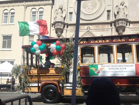 A trolley representing the San Francisco Italian Athletic Club passes in front of Saints Peter and Paul Catholic Church in San Francisco during preparations for a parade commemorating Columbus Day on Oct. 13, 2013. (Photo by John Ferrannini)