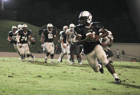 American River College running back Wadus Parker runs upfield during last season's 24-14 win over College of San Mateo. ARC, ranked no.1 in NorCal, will travel to San Mateo, ranked no.2 in NorCal, Saturday in a rematch of last season's game. (File Photo)
