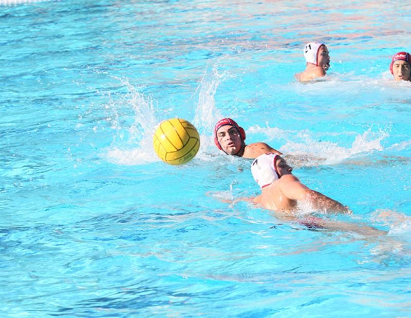 A ball skips across the water as American River College attacker Austen Takahashi fights for possession of the ball. Sierra defeated ARC by a score of 4-3 on October 21, 2015 and ARC is now 2-2 in conference. (Photo by Nicholas Corey)