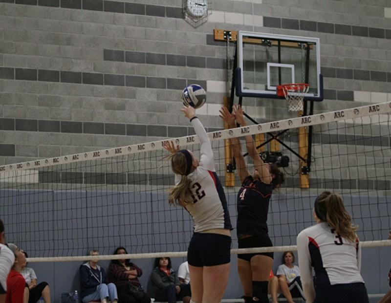 American River College middle blocker Erin Fogarty gently tips the ball into Cosumnes territory. ARC rolled to a victory with scores of 25-14, 25-11, 25-22 sweeping CRC on October 21, 2015.(Photo by Nicholas Corey)