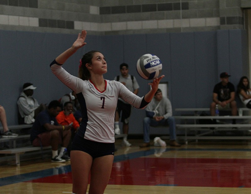 Monica Udahl, safety for American River College prepares her serve to Cosumnes October 21, 2015.  Cosumnes fell to ARC 3-0 with scores of 25-14, 25-11, 25-22 which improved ARC's home record to 9-1 on the year. (Photo by Nicholas Corey)