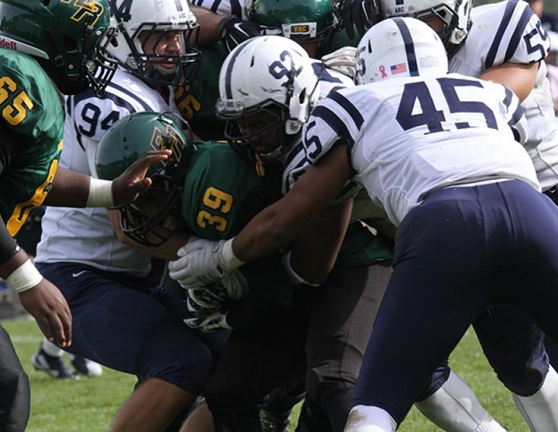 American River College's defense swarms Feather River running back Daniel Lindsey on October 24, 2015.  ARC held Feather River to 102 yards on the ground in its 44-14 win.(Photo by Nicholas Corey)
