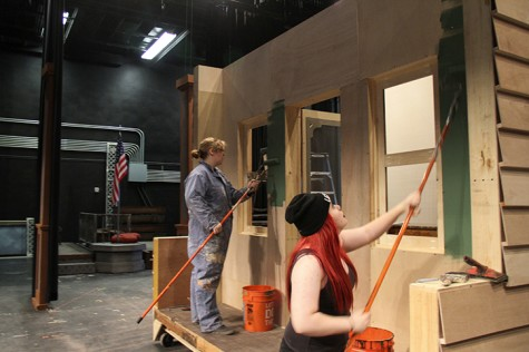 American River College students Alice Morgan, left, and Kori Einsel build the sets for the upcoming theater production of