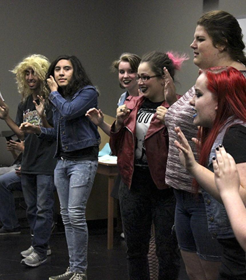 A group of student volunteers playing a game where they had to yell out things following the topic given during the punk rock themed late night meeting of the American River College Improv club on Thursday, Sept. 24. (Photo by Ashlynn Johnson)