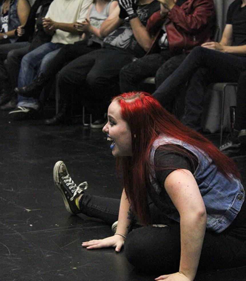 Kori Einsel, who is in charge of public relations for the American River College Improv club, laughing at the volunteers acting in one of the games played during the clubs late night meeting. The club held a meeting filled with volunteers competing in games and acting in skits from 10 p.m. to 12:00 a.m. with the theme of punk rock on Thursday, Sept. 24. (Photos by Ashlynn Johnson)