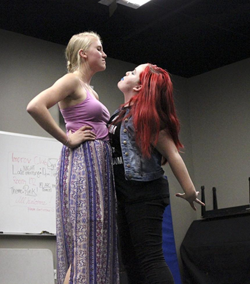 Annelies Veldman, left, and Kori Einsel, right, both members of the American River College Improv club acting out a fighting scene during a skit they acted in at the clubs meeting Thursday, Sept. 24. The club had a punk rocked themed late night meeting from 10 p.m. to midnight on campus that was filled with volunteers acting out skits and playing games. (Photos by Ashlynn Johnson)