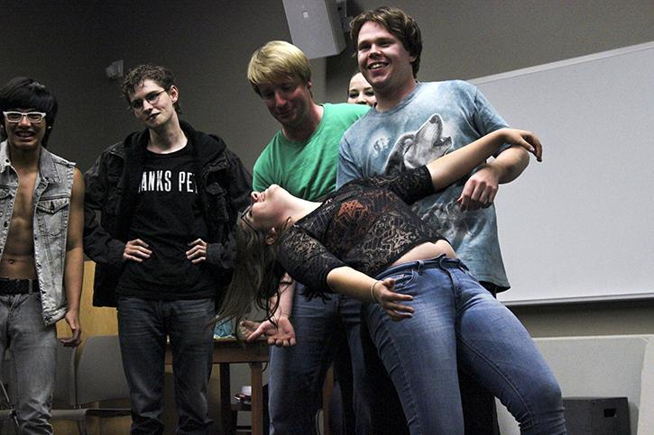 From left to right, Keanu Hoohuli, Zach Ekstedt, Spencer Murrish, Patrick Holland, and Mckayla Peterson acting out a skit where Peterson was an actor, Holland was a director and the other actors were his other personalities. Volunteers at the Improv club meeting on Thursday, Sept. 24 acted out skits like this and also participated in games from 10 p.m. to midnight on the American River College campus.  (Photo by Ashlynn Johnson)