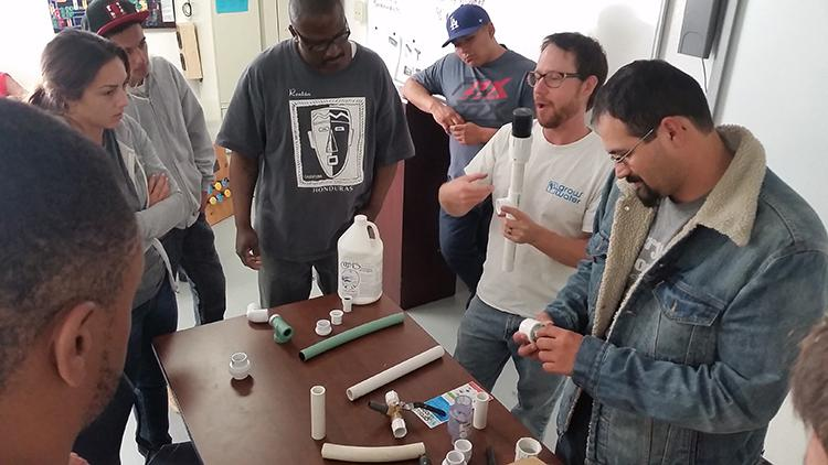 Students in the pre-apprenticeship program at American River College participate in a gray water recovery lab. The Los Rios district and ARC spearheaded an effort to receive a $5 million grant from the federal government for apprenticeships. (Photo courtesy of Richard Stoker)