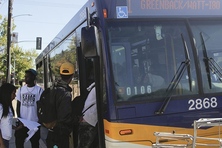 American River College students board the No. 1 bus at Orange Grove Avenue and College Oak Drive. A crime bulletin was sent out to ARC students that said a woman was robbed at the bus stop late Monday. (Photo by Joseph Daniels)