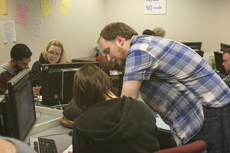 Mathematics assistant professor Matthew Register is helping a student at the Math Learning Center. Register worked at the MLC on October 28, 2015. (Photo by Mychael Jones)