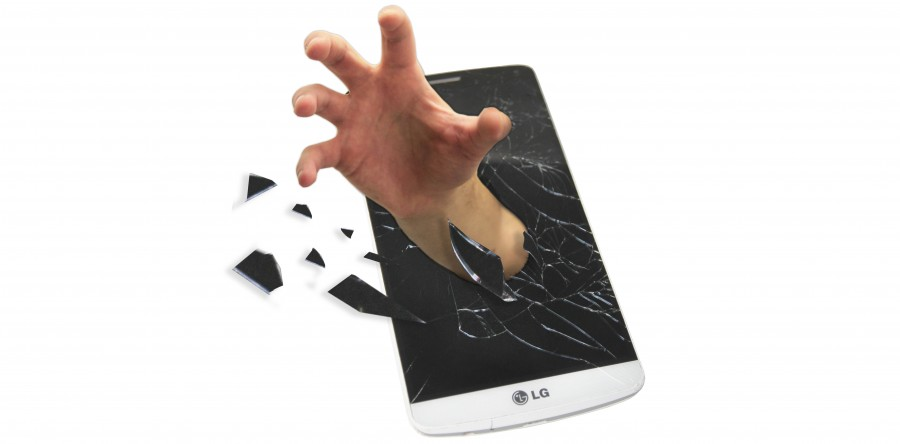 A photo illustration depicts a hand breaking through the screen of a cellphone. It has been said that at the beginning of each morning, 62 percent of people grab for the phone that is more than likely tucked beside their pillow (Photo illustration by Lena DoBynes).