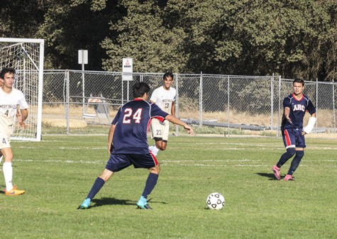 ARC midfielder Chris Cruz y Corro attempts to deliver a pass to forward Hector Zavala. ARC won 1-0 on Tuesday. (Photo by Jose Garcia)