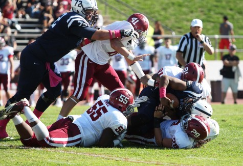 American River College quarterback Jihad Vercher is brought down by the Sierra College defense during ARC's 47-22 victory over rival Sierra College on Saturday, Oct. 31, 2015. (Photo by Barbara Harvey)