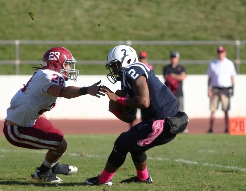 American River College quarterback Jihad Vercher attempts to evade Sierra College linebacker Hank Humphers during ARC's 47-22 victory over rival Sierra on Saturday, Oct. 31, 2015. (Photo by Barbara Harvey)