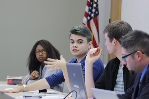 Sen. James Cortright discusses a resolution in support of a proposed LGBT pride center on campus at Thursday's meeting of the Student Senate (Photo by Jordan Schauberger).