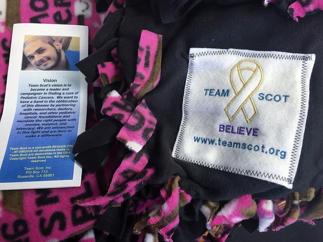 Team Scot is a non-profit organization with the goal of spreading awareness to a rare form of cancer, rhabdomyosarcoma. The charity was started after Scot Sieczko died and the organization goes around to hospitals and passes around blankets with a Team Scot patch on it to help make children going through cancer happier. (Photo by Joseph Daniels)
