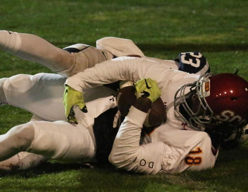 American River College defensive back Josh Houston brings down Sacramento City College's Justin Yeaton during ARC's 38-18 win over SCC on Nov. 14, 2015. (Photo by Barbara Harvey)