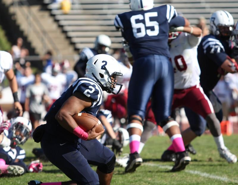 American River College quarterback Jihad Vercher rushes the ball during ARC football's 47-22 win over rival Sierra College on Saturday, Oct. 31, 2015. (Photo by Barbara Harvey)