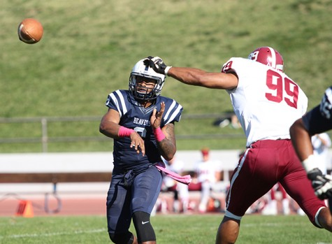 American River College quarterback Jihad Vercher passes under pressure during ARC football's 47-22 win over rival Sierra College on Saturday, Oct. 31, 2015. (Photo by Barbara Harvey)