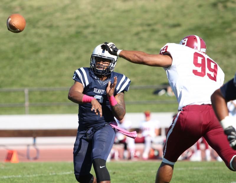 American River College quarterback Jihad Vercher passes under pressure during ARC football's 47-22 win over rival Sierra College on Saturday, Oct. 31, 2015. (Photo by Barbara Harvey)