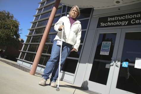 American River College Computer Instructional Assistant Tiffany Manosh stands outside the Instructional Technology Center with her new walking cane. Manosh, who is visually impaired, had her previous cane snapped by someone who stepped on it as she exited the bathroom in the Liberal Arts breezeway. (Photo by Matthew Peirson)