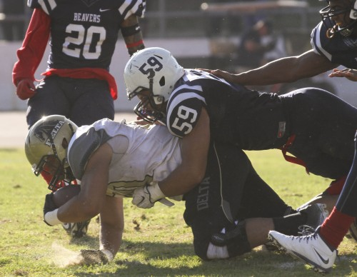 ARC linebacker Jordan Kunasyzk tackles SDJC tight end Johhny Weirnicki during the Gridiron Classic Bowl on Saturday, Nov. 21, 2015. ARC lost 24-17 in overtime. (Photo by Jordan Schauberger)