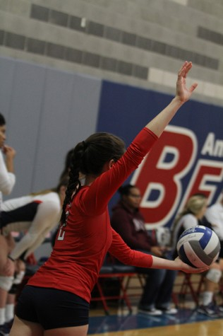 American River College libero Emily Dzubak prepares to serve in ARC's 3-0 win over Modesto Junior College on Nov. 11, 2015. With the win, ARC's win streak increased to three games in a row, and its overall record is now 19-7. (Photo by Kevin Sheridan)