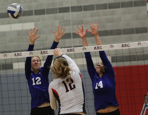 American River College middle blocker Erin Fogarty(12), returns a serve in ARC's 3-0 win against Modesto Junior College on Nov. 11, 2015. With the win, ARC's win streak increased to three in a row and its record now stands at 19-7. (Photo by Kevin Sheridan)