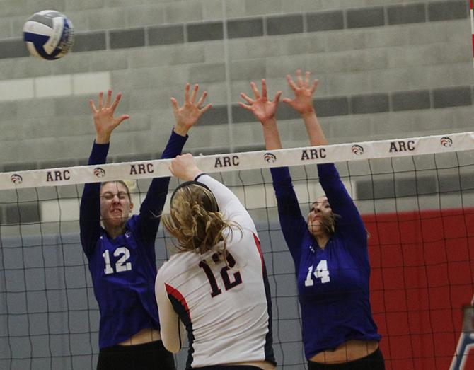 American+River+College+middle+blocker+Erin+Fogarty%2812%29%2C+returns+a+serve+in+ARC%27s+3-0+win+against+Modesto+Junior+College+on+Nov.+11%2C+2015.+With+the+win%2C+ARC%27s+win+streak+increased+to+three+in+a+row+and+its+record+now+stands+at+19-7.+%28Photo+by+Kevin+Sheridan%29