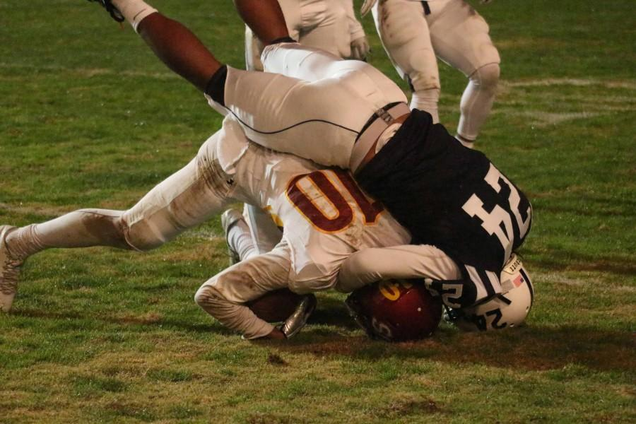 American River College defensive back Dmitri Scott tackles Sacramento City College wide receiver Keylan Mack during ARC's 38-18 win over SCC on Saturday, Nov. 14, 2015. (Photo by Barbara Harvey)