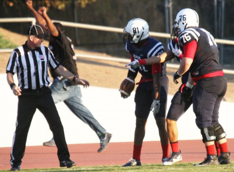 American River College wide receiver Malik Dumetz disputes the referee's call that he was out-of-bounds during the final play of the Gridiron Classic Bowl against San Joaquin Delta College on Saturday, Nov. 21, 2015. ARC lost 24-17 in overtime. (Photo by Barbara Harvey)