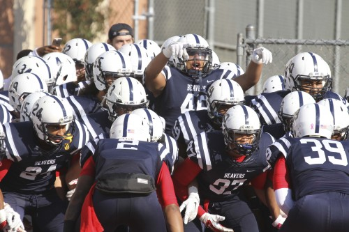ARC players link arms and dance before they take the field during the Gridiron Classic Bowl on Saturday, Nov. 21, 2015. ARC lost 24-17 in overtime. (Photo by Jordan Schauberger)