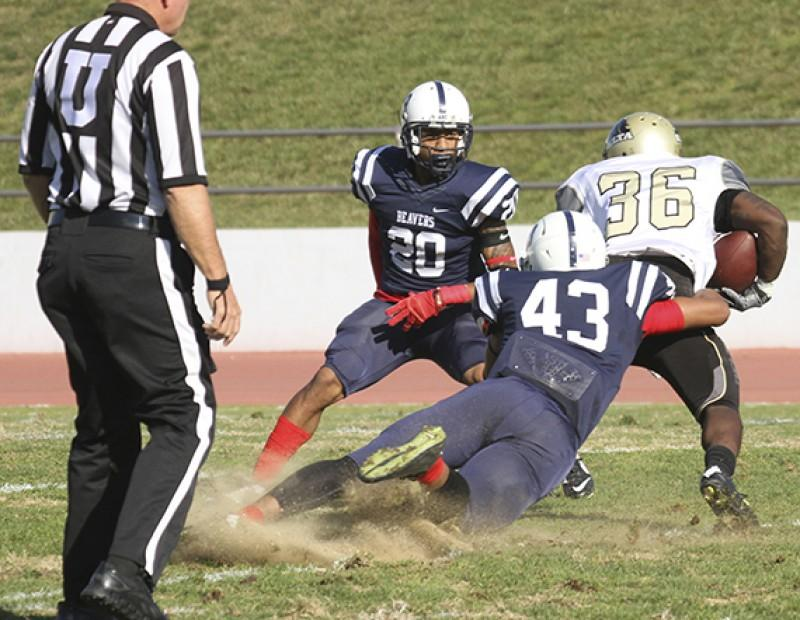 ARC linebacker Patrick Walker and defensive back Robert Sanders attempt to tackle SJDC running back Jamil Thomas during the Gridiron Classic Bowl on Saturday. ARC lost 24-17 in overtime. (Photo by Jordan Schauberger)