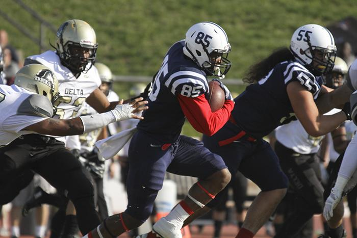 ARC+wide+receiver+Torian+Williams+evades+tackles+during+the+Gridiron+Classic+Bowl+on+Saturday.+ARC+lost+24-17+in+overtime.+%28Photo+by+Jordan+Schauberger%29