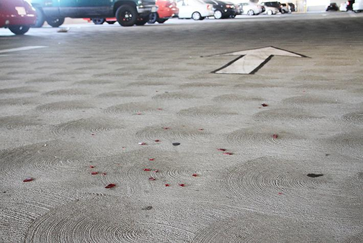 Debris remains on the second floor of the parking structure at American River College the day after a hit and run incident occurred during a police chase. (Photo by Barbara Harvey)