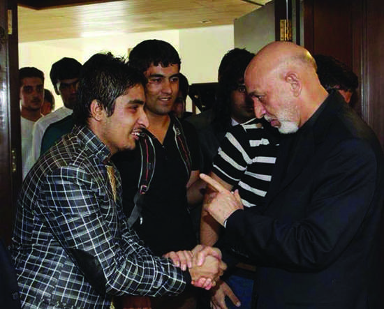 Hamid Hafezy, left, meets then-Afghan President Hamid Karzai at the Afghan Embassy India in New Delhi in 2012. Hafezy, now an American River College student, said that he told Karzai about the conditions for Afghan scholars in India. (Courtesy of Hamid Hafezy)