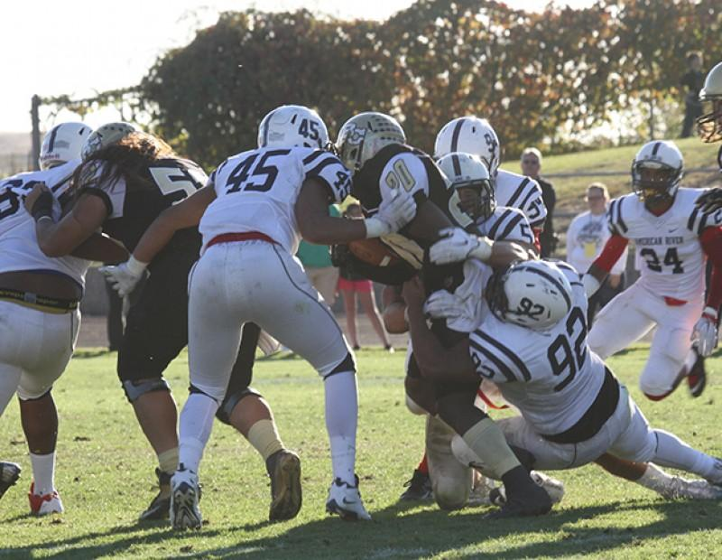 American River College's defense attacks Butte running back Martin Fleming after one of his 17 carries for 89 yards on Nov. 7, 2015. ARC lost 27-24, ARC's defense gave up 130 yards on the ground. (Photo by Nicholas Corey)