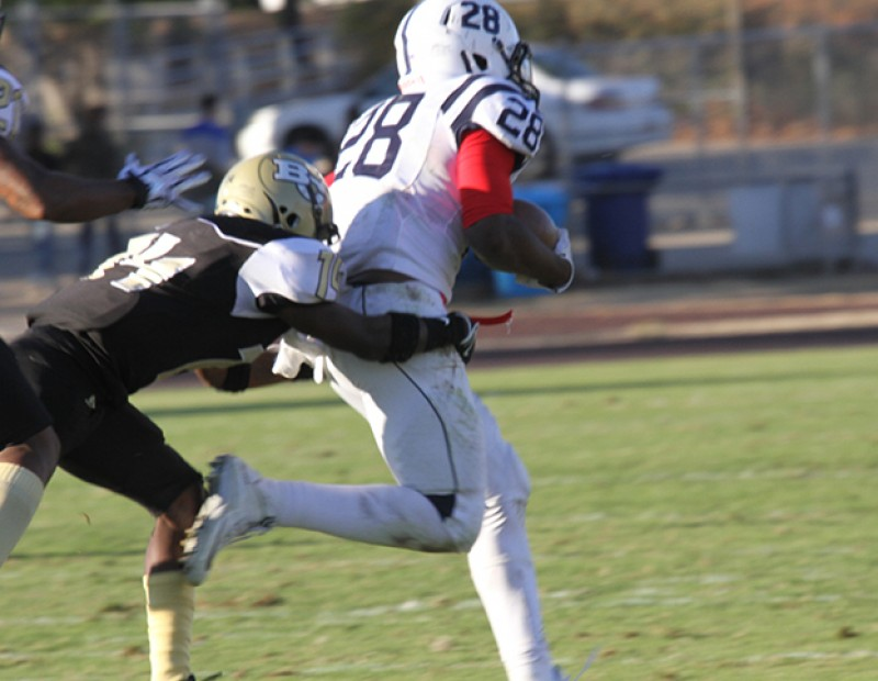 American River College running back Armand Shyne gallops past the Butte defense for a score on Nov. 7, 2015. ARC fell to Butte in a close game 27-24.  (Photo by Nicholas Corey)