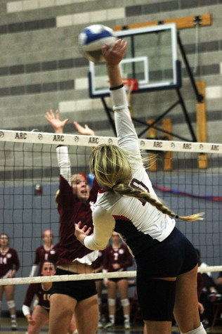 American River College offensive hitter Kaitlin Meyer swats the ball as a Sierra College defender rises to block. Sierra won the match by a score of 25-23, 25-21, 25-18, 25-20 on Nov. 13, 2015. (Photo by Nicholas Corey)
