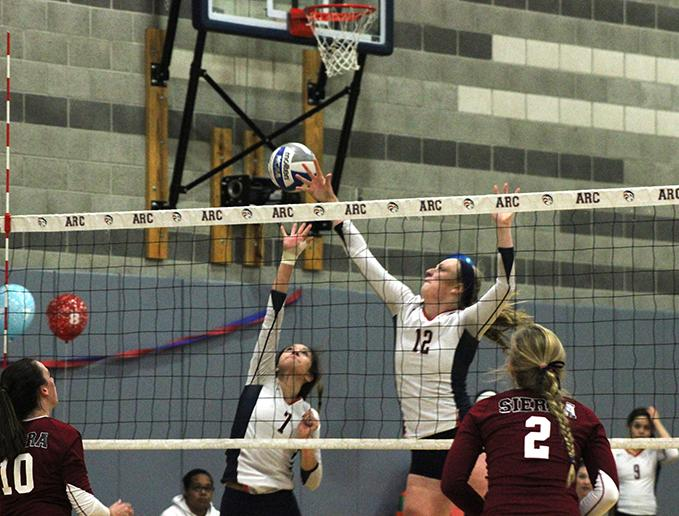 Erin+Fogarty+and+Monica+Udahl+of+American+River+College+attempt+to+block+a+ball+from+Sierra+College+on+Nov.+13%2C+2015.+ARC+lost+to+Sierra+by+a+score+of+25-23%2C+25-21%2C+25-18%2C+25-20.+%28Photo+by+Nicholas+Corey%29