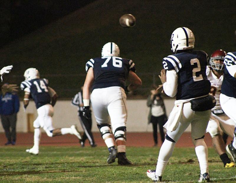 American River College quarterback Jihad Vercher tosses the ball down the field against Sacramento City College on Nov. 14, 2015. Vercher threw for over 350 yards with two touchdowns on 22 of 34 attempts and ARC crushed Sac City 38-18. (Photo by Nicholas Corey)